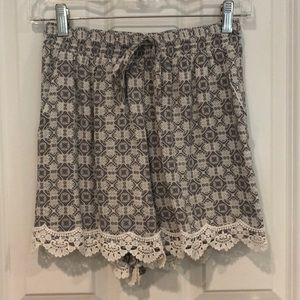 gray and white patterned flowy shorts